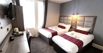 舒适绿色酒店 - 伦敦 - 睡房