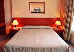 Manduara Hotel And Suites - 亚松森 - 睡房
