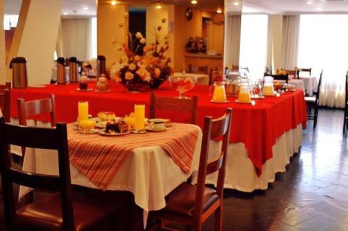 Manduara Hotel And Suites - 亚松森 - 餐厅