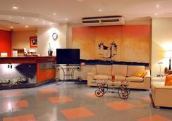 Manduara Hotel And Suites - 亚松森 - 大厅