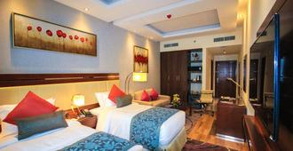 阿尔巴沙玫瑰公园酒店 - 迪拜 - 睡房