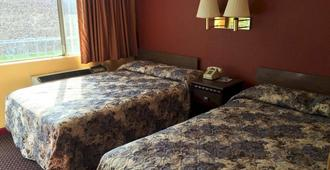 速 7 酒店 - 小石城 - 睡房