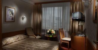 罗斯尊贵酒店 - 基辅 - 睡房