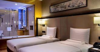 青岛紫玥铂尔曼酒店 - 青岛 - 睡房