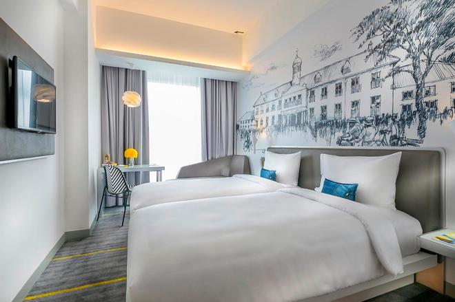 哈尔莫尼耶罗酒店 - 雅加达 - 睡房