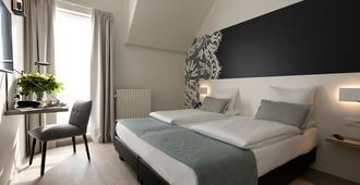 布鲁日马丁斯酒店 - 布鲁日 - 睡房