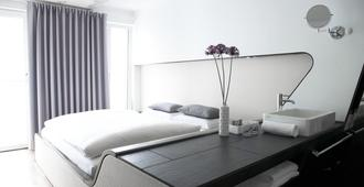 Q酒店 - 柏林 - 睡房