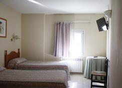 卡耐伽胡安酒店 - 莱斯 - 睡房