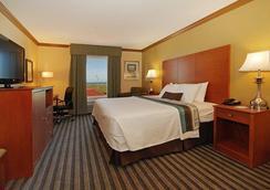 贝斯特韦斯特优质海滨海堤酒店及套房 - Galveston - 睡房