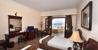 马萨阿拉姆科罗希尔度假村及水疗中心 - 式 - 库塞尔 - 睡房