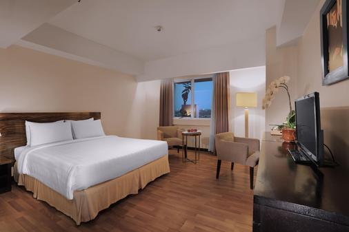 阿斯顿布拉万隆酒店和公寓 - 万隆 - 睡房