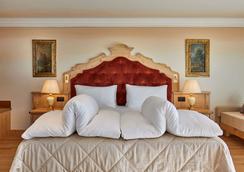 莎颂葛雷酒店 - 科瓦拉因巴迪亚 - 睡房