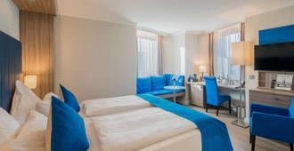 丽晶贝斯特韦斯特Plus酒店 - 亚琛 - 睡房