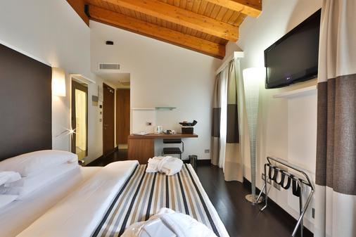 贝斯特韦斯特德卡布雷缇酒店 - 维罗纳 - 睡房