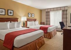 布卢明顿诺莫尔机场丽怡酒店 - 布卢明顿 - 睡房