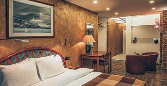 超级8号酒店 - 斯科普里 - 睡房