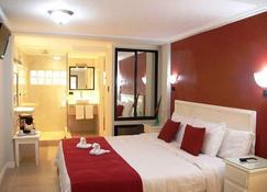科帕卡巴纳套房酒店 - 限成人 - 哈科 - 睡房