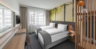 慕尼黑鲁克登贝尔格林安吉洛酒店 - 慕尼黑 - 睡房