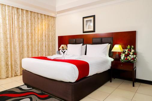 阿吉曼伊万套房酒店 - 阿吉曼 - 睡房