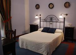 阿尔瓦法尼恩酒店 - 乌韦达 - 睡房