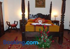安地瓜之家酒店 - 安地瓜 - 睡房