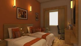 加淇保里檸檬樹飯店 - 海得拉巴 - 睡房