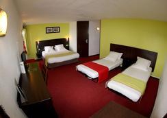 基里亚德设计恩佐蒙卢松圣维克多酒店 - Montlucon - 睡房