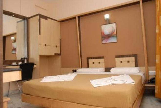 摩纳娑天堂酒店 - 班加罗尔 - 睡房