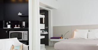马拉加中心诺富特套房酒店 - 马拉加 - 睡房