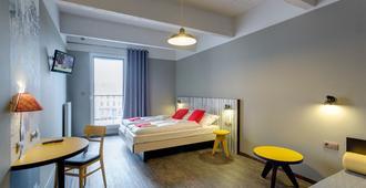 布鲁塞尔市中心梅宁格尔酒店 - 布鲁塞尔 - 睡房