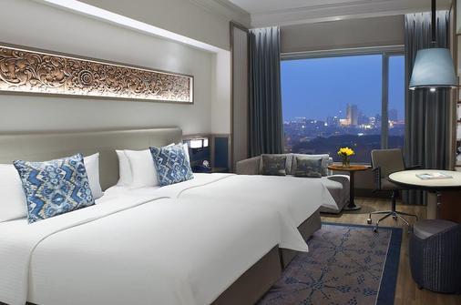 泗水香格里拉酒店 - 泗水 - 睡房