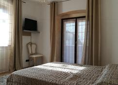 乐奇科格尼酒店 - 罗韦雷托 - 睡房