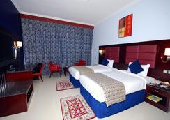 拉米玫瑰公寓酒店 - 阿布扎比 - 睡房
