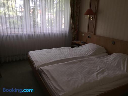沙佩尔克鲁格酒店 - 策勒 - 睡房
