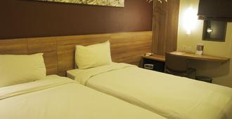 G7飯店 - 雅加达 - 睡房