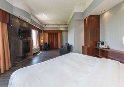利维斯套房质量假日酒店 - 莱维斯 - 睡房