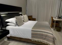 郊区酒店 - 布隆方丹 - 睡房