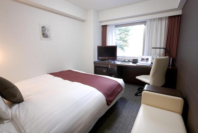 新横滨大和鲁内酒店 - 横滨 - 睡房