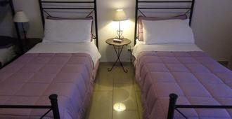 艾曼努尔家庭旅馆 - 雷焦卡拉布里亚 - 睡房