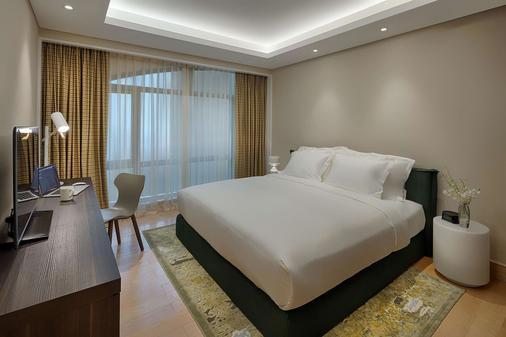 舍伍德套房酒店 - 胡志明市 - 睡房