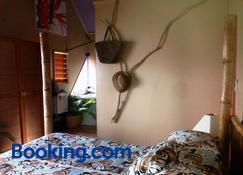 纳威利亚高地旅馆 - 萨武萨武 - 睡房
