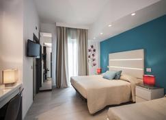 莱万特酒店 - 里米尼 - 睡房