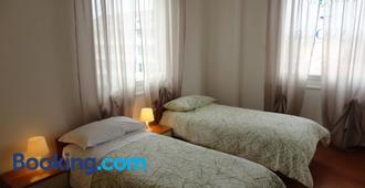 阿罗吉奥凯沃尔酒店 - 费拉拉 - 睡房