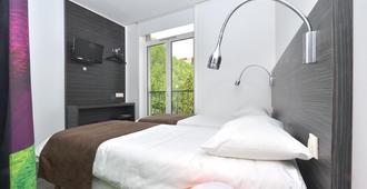 科里亚德南特格拉斯兰中心酒店 - 南特 - 睡房