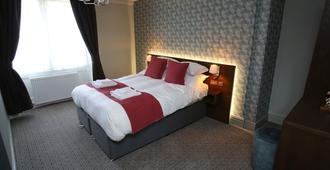 皇后之首酒店 - 莫珀斯 - 睡房