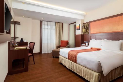 马卡萨海滩贝斯特韦斯特高级酒店 - 马卡萨 - 睡房