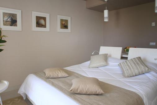 吉尔巴岛西贝尔莱姆海滩度假村 - 米多恩 - 睡房
