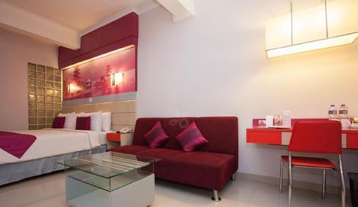 奇哈佩拉斯普利米尔法福酒店 - 万隆 - 睡房
