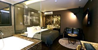 釜山天堂2号酒店 - 釜山 - 睡房