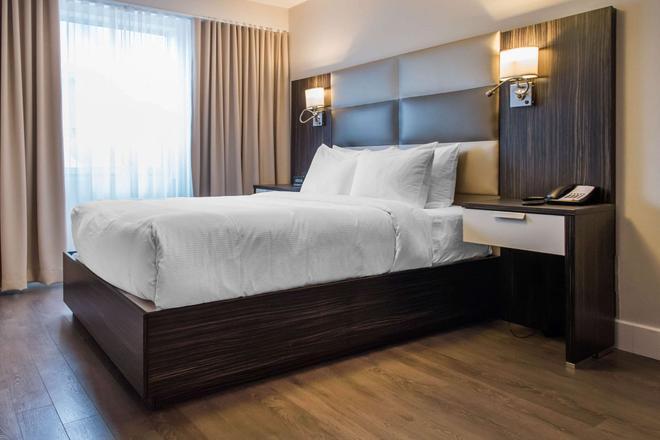 维多利亚套房酒店 - 加蒂诺 - 睡房